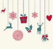 Feliz Natal que pendura estuques dos elementos da decoração Foto de Stock