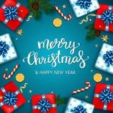 Feliz Natal que rotula no fundo azul, backgro do Natal Fotografia de Stock Royalty Free