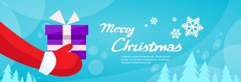 Feliz Natal Santa Claus Hands Hold Gift Box ilustração do vetor
