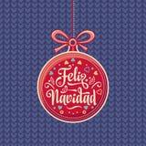 Feliz Navidad 与好愿望的红色圣诞节球用西班牙语 免版税库存图片
