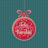 Feliz Navidad 与好愿望的红色圣诞节球用西班牙语 免版税库存照片