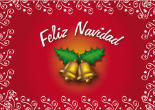 Feliz Navidad. Golden bells over a red background (Spanish greeting card Stock Photography