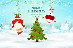 Feliz Navidad Feliz Año Nuevo Santa Claus, colgante del muñeco de nieve al revés en escena de la nieve de la Navidad con nieve qu imagen de archivo