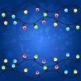 Feliz Navidad con las luces de la Navidad que brillan intensamente coloridas Imagen de archivo libre de regalías
