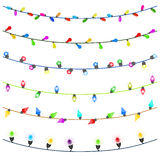 Feliz Navidad con las luces de la Navidad que brillan intensamente coloridas Imágenes de archivo libres de regalías