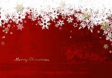 Feliz Navidad con las porciones de copos de nieve en fondo rojo Fotografía de archivo libre de regalías