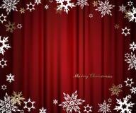 Feliz Navidad con las porciones de copos de nieve en fondo rojo Foto de archivo