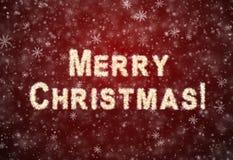 Feliz Navidad de la inscripción de los copos de nieve Imagen de archivo