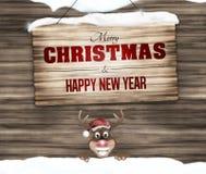 Feliz Navidad de la muestra de madera y Feliz Año Nuevo Imagen de archivo