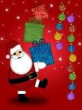 Feliz Navidad de los presentes de Papá Noel que lleva Foto de archivo libre de regalías