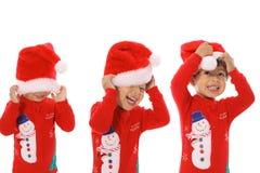 Feliz Navidad de tres niños Fotografía de archivo