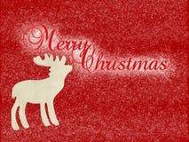 Feliz Navidad del reno de madera Imagen de archivo