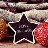 Feliz Navidad del texto en una pizarra asteroide Foto de archivo libre de regalías