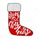 Feliz Navidad en calcetín rojo en fondo del vintage Fotografía de archivo libre de regalías