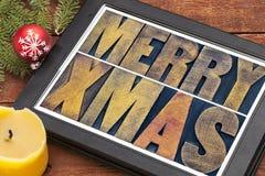 Feliz Navidad en la tableta digital Fotografía de archivo libre de regalías