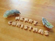 Feliz Navidad escrita con las galletas Fotografía de archivo libre de regalías