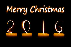 Feliz Navidad 2016 escrita con las llamas de vela Imagenes de archivo