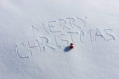 Feliz Navidad escrita en la nieve Fotografía de archivo