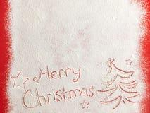 Feliz Navidad escrita en la nieve blanca Fotografía de archivo libre de regalías