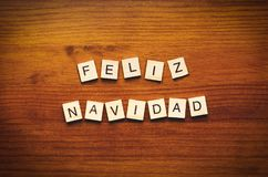 Feliz Navidad. Text on a wooden background royalty free stock image
