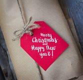 Feliz Navidad festiva de la tarjeta de felicitación y Feliz Año Nuevo con efecto de la nieve Fotografía de archivo