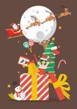 Feliz Navidad fuera de la caja de regalo grande Foto de archivo