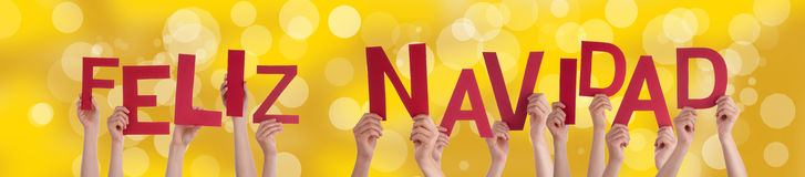 Feliz Navidad on Golden Background Stock Images