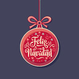 Feliz navidad. Greeting card in Spain. Xmas festive background. Colorful vector image of a red Christmas ball. Translated from Spanish - merry Christmas Royalty Free Stock Photo