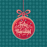 Feliz navidad. Greeting card in Spain. Xmas festive background. Colorful vector image of a red Christmas ball. Translated from Spanish - merry Christmas Stock Photography
