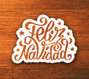Feliz navidad hand lettering sticker on wood Royalty Free Stock Photography
