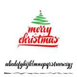 Feliz Navidad, insignia de Navidad con las letras manuscritas Imagenes de archivo