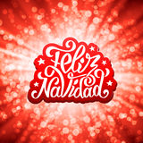 Feliz navidad lettering. Merry Christmas greetings Royalty Free Stock Image