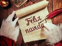 Feliz Navidad manuscrit ou Joyeux Noël photo stock