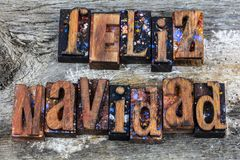 Feliz Navidad Merry Christmas letterpress. Feliz Navidad Merry Christmas greeting celebration letterpress wood block letters words barn holiday greetings message Stock Photos