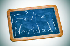 Feliz navidad, merry christmas in spanish Royalty Free Stock Image