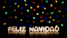 Feliz navidad, merry christmas in Spanish language. Text, beautiful multicolor bokeh background with copy space royalty free stock photography