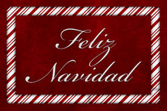Feliz Navidad. A Feliz Navidad message, A Candy Cane border with the words Feliz Navidad over red plush background royalty free stock photography