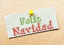 Feliz Navidad Message. Recycled paper note pinned on cork board. Feliz Navidad Message. Concept Image stock image