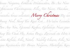 Feliz Navidad multilingue Imágenes de archivo libres de regalías