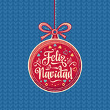 Feliz Navidad.  Red Christmas ball with good wishes in Spanish. Colorful greeting card Stock Photo