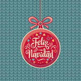 Feliz Navidad.  Red Christmas ball with good wishes in Spanish. Colorful greeting card Royalty Free Stock Photography
