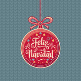 Feliz Navidad.  Red Christmas ball with good wishes in Spanish. Colorful greeting card Royalty Free Stock Photos