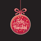 Feliz Navidad.  Red Christmas ball with good wishes in Spanish. Colorful greeting card Stock Photos