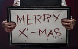 Feliz Navidad sangriento. Imagen de archivo libre de regalías