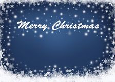 Feliz Navidad sobre fondo azul abstracto Fotografía de archivo libre de regalías