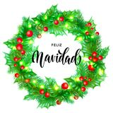 Feliz Navidad Spanish Merry Christmas hand drawn calligraphy and holly wreath decoration with golden lights garland frame for holi Royalty Free Stock Photos