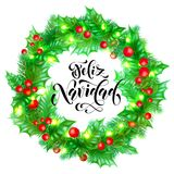 Feliz Navidad Spanish Merry Christmas hand drawn calligraphy and holly wreath decoration with golden lights garland frame for holi. Day greeting card background Stock Image