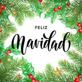 Feliz Navidad Spanish Merry Christmas hand drawn calligraphy and holly wreath decoration with golden stars garland frame for holid. Ay greeting card background Stock Image