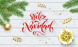 Feliz Navidad Spanish Merry Christmas holiday golden decoration on Xmas tree, calligraphy font for greeting card white wooden back royalty free illustration