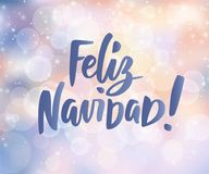 Feliz Navidad - spanish Merry Christmas text. Holiday greetings quote. Blurred winter background with falling snow. Feliz Navidad - spanish Merry Christmas text Stock Images